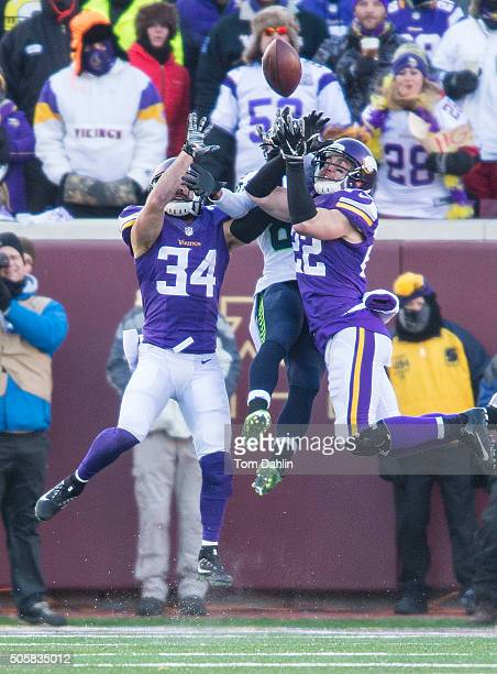 Andrew Sendejo and Harrison Smith of the Minnesota Vikings break up a pass intended for Doug Baldwin of the Seattle Seahawks during an NFL game...