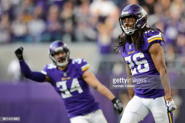 Andrew Sendejo and Trae Waynes of the Minnesota Vikings celebrate a play against the Chicago Bears during the game on December 31, 2017 at U.S. Bank...