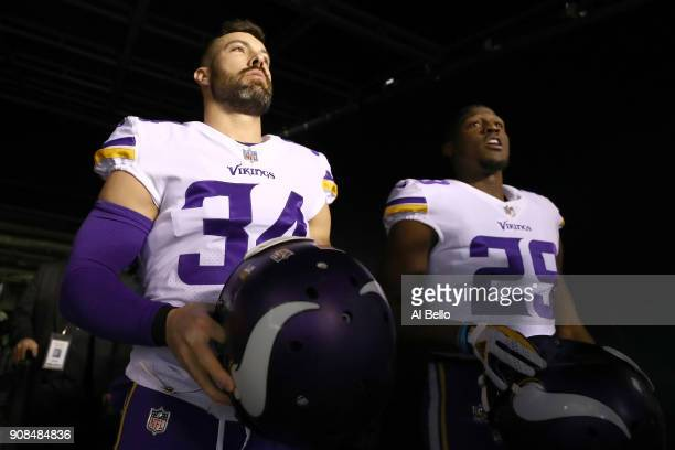 Andrew Sendejo and Xavier Rhodes of the Minnesota Vikings walk out on the field for warm ups prior to the NFC Championship game against the...