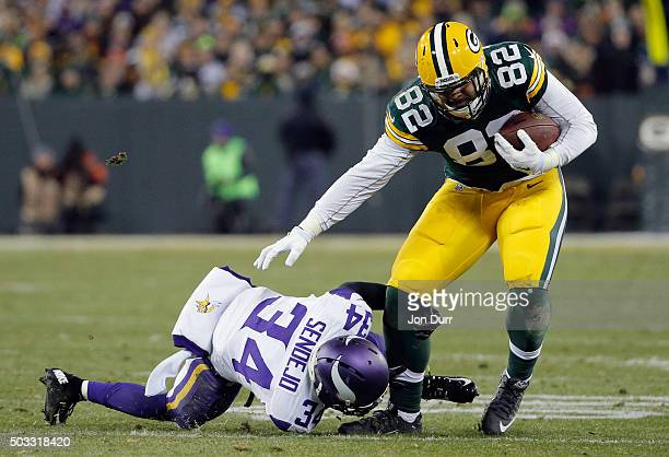 Andrew Sendejo of the Minnesota Vikings attempts to tackle Richard Rodgers of the Green Bay Packers during the second half of their game at Lambeau...
