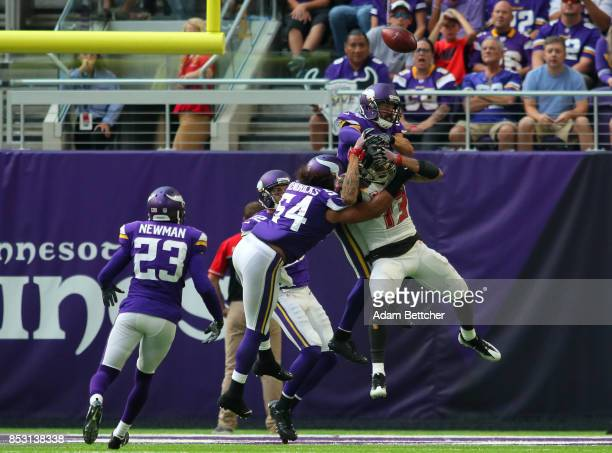 Andrew Sendejo of the Minnesota Vikings breaks up a pass intended for Mike Evans of the Tampa Bay Buccaneers the ball was intercepted by Harrison...
