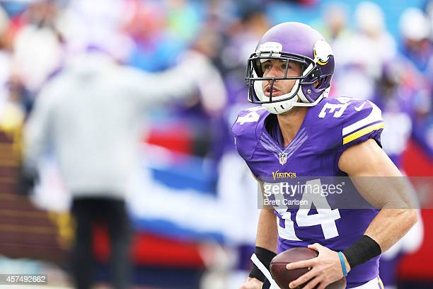 Andrew Sendejo of the Minnesota Vikings catches a ball during warmups before the first half against the Buffalo Bills at Ralph Wilson Stadium on...