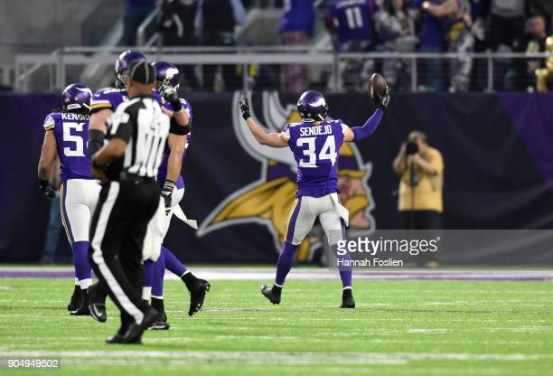 Andrew Sendejo of the Minnesota Vikings celebrates after intercepting Drew Brees of the New Orleans Saints in the first quarter of the NFC Divisional...