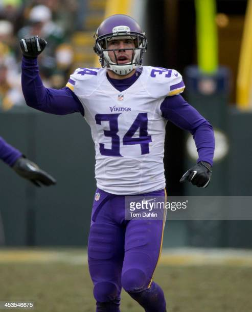 Andrew Sendejo of the Minnesota Vikings celebrates during an NFL game against the Green Bay Packers at Lambeau Field November 24 2013 in Green Bay...