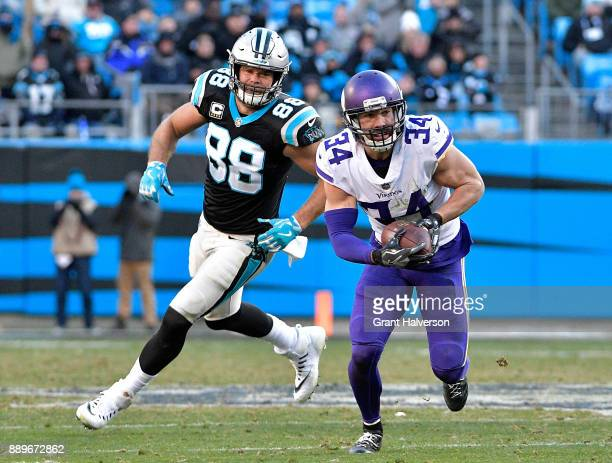 Andrew Sendejo of the Minnesota Vikings intercepts a pass intended for Greg Olsen of the Carolina Panthers during their game at Bank of America...