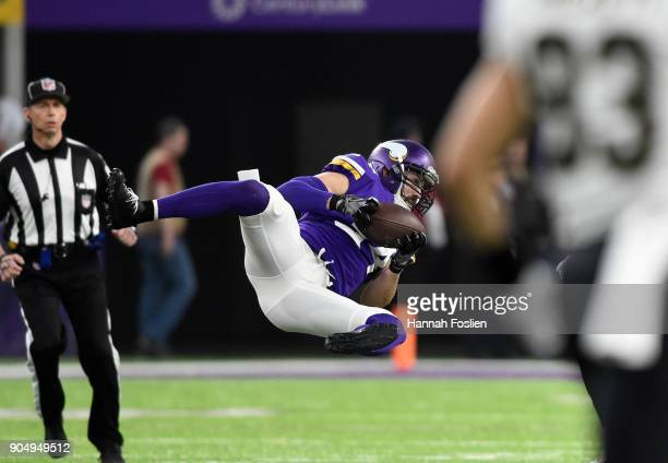 Andrew Sendejo of the Minnesota Vikings intercepts the ball in the first quarter of the NFC Divisional Playoff game against the New Orleans Saints on...