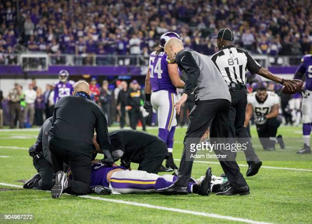 Andrew Sendejo of the Minnesota Vikings is evaluated by trainers on the field after suffering an injury in the third quarter of the NFC Divisional...