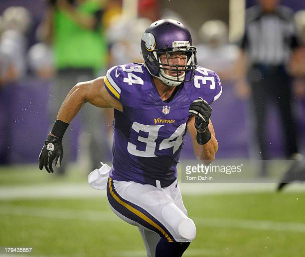 Andrew Sendejo of the Minnesota Vikings runs across the field during an NFL game against the Tennessee Titans at Mall of America Field on August 29...