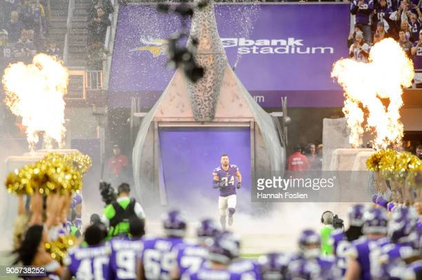 Andrew Sendejo of the Minnesota Vikings runs onto the field during player introductions before the NFC Divisional Playoff game against the New...