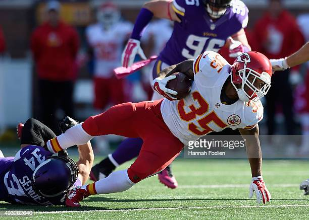 Andrew Sendejo of the Minnesota Vikings tackles Charcandrick West of the Kansas City Chiefs during the fourth quarter of the game on October 18 2015...