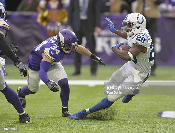Andrew Sendejo of the Minnesota Vikings tackles Jordan Todman of the Indianapolis Colts during an NFL game against the Indianapolis Colts at US Bank...