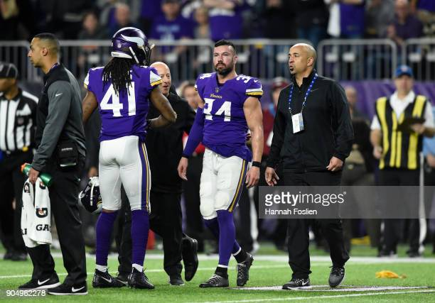 Andrew Sendejo of the Minnesota Vikings walks off the field with trainers after suffering an injury in the third quarter of the NFC Divisional...