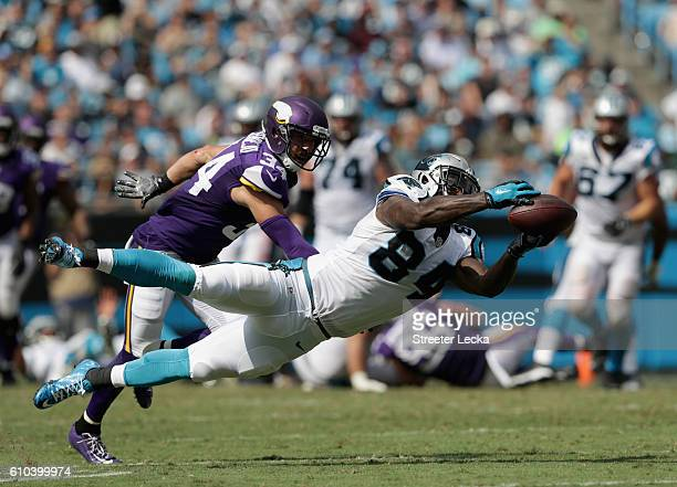 Andrew Sendejo of the Minnesota Vikings watches as Ed Dickson of the Carolina Panthers dives for the ball during their game at Bank of America...