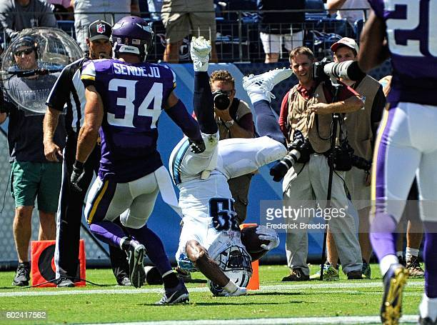 Andrew Sendejo of the Minnesota Vikings watches DeMarco Murray of the Tennessee Titans dive into the end zone for a touchdown during the first half...