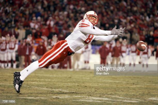 Andrew Shanie of the Nebraska Cornhuskers leaps for the reception against the Oklahoma Sooners late in the fourth quarter of the 2006 Dr Pepper Big...