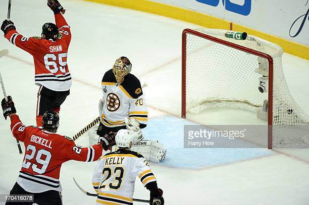 Andrew Shaw of the Chicago Blackhawks celebrates after he scored the gamewinning goal in the third overtime against goalie Tuukka Rask of the Boston...