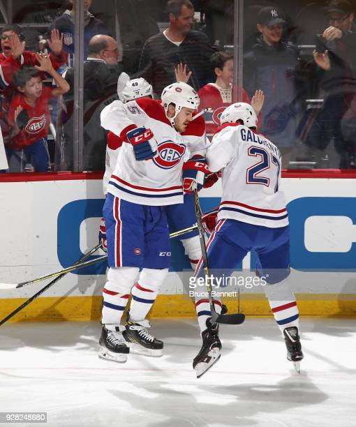 Andrew Shaw and Alex Galchenyuk of the Montreal Canadiens bump during warmups prior to the game against the New Jersey Devils at the Prudential...