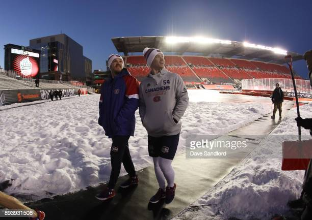 Andrew Shaw and Charles Hudon of the Montreal Canadiens check out the stadium in advance of the 2017 Scotiabank NHL100 Classic at Lansdowne Park on...