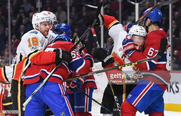Andrew Shaw and Max Pacioretty of the Montreal Canadiens get into a scrum with Matt Stajan and Mark Giordano of the Calgary Flames in the NHL game at...