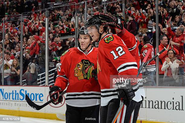 Andrew Shaw and Peter Regin of the Chicago Blackhawks celebrate after Regin scored against the Nashville Predators in the third period during the NHL...