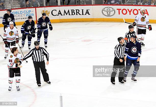 Andrew Shaw of the Chicago Blackhawks and Ben Chiarot of the Winnipeg Jets are separated by the linesmen following a second period fight at the MTS...