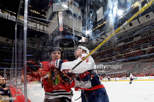 Andrew Shaw of the Chicago Blackhawks and Brooks Orpik of the Washington Capitals get physical in the first period of the NHL game at the United...