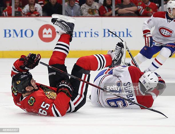 Andrew Shaw of the Chicago Blackhawks and PK Subban of the Montreal Canadiens hit the ice after a collision at the United Center on April 9 2014 in...