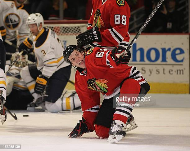 Andrew Shaw of the Chicago Blackhawks celebrates a first period goal against the Buffalo Sabres at the United Center on January 18 2012 in Chicago...