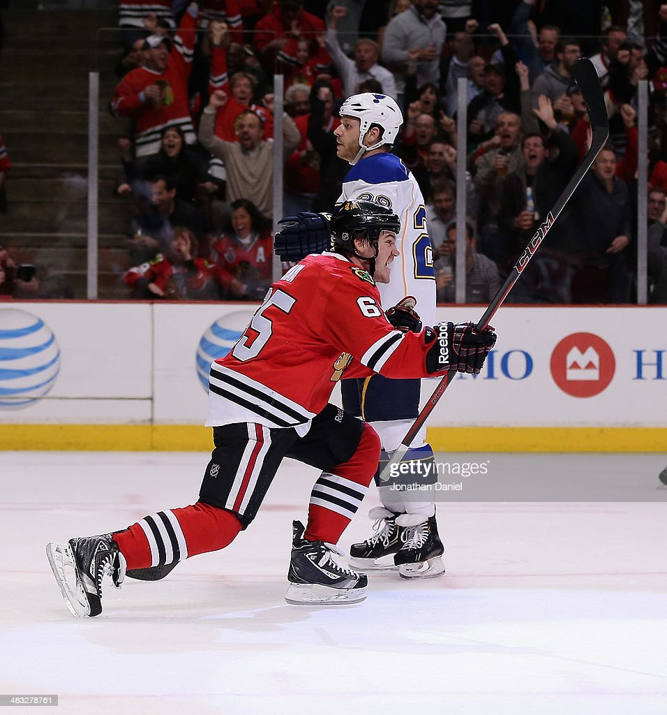 Andrew Shaw #65 of the Chicago Blackhawks celebrates a second period goal as he skates past Steve Ott #29 of the St. Louis Blues at the United Center on March 19, 2014 in Chicago, Illinois. The Blackhawks defeated the Blues 4-0.