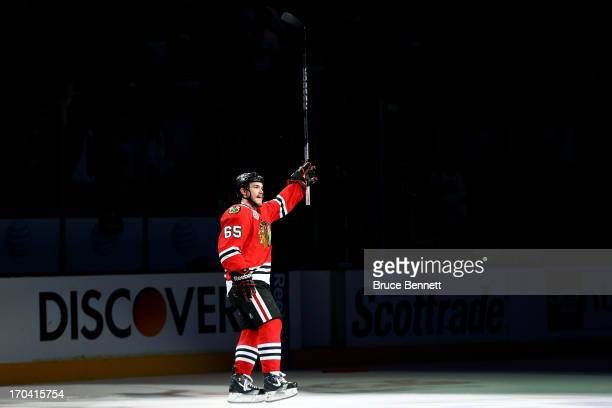 Andrew Shaw of the Chicago Blackhawks celebrates after he was named a star of the game after they won 43 in the third overtime against the Boston...