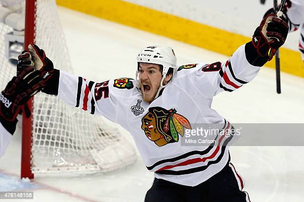 Andrew Shaw of the Chicago Blackhawks celebrates after scoring a goal against Ben Bishop of the Tampa Bay Lightning during the second period in Game...
