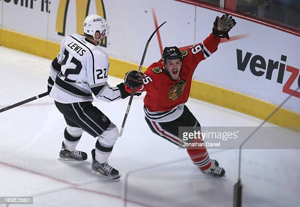 Andrew Shaw of the Chicago Blackhawks celebrates his goal in the first period of Game Two of the Western Conference Final as Trevor Lewis of the Los...
