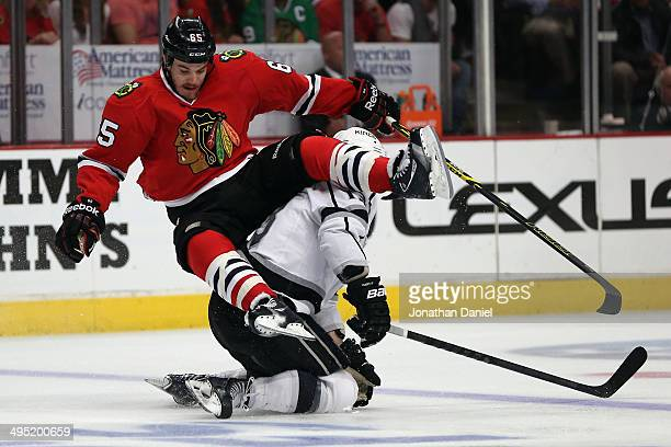 Andrew Shaw of the Chicago Blackhawks collides with Kyle Clifford of the Los Angeles Kings during Game Seven of the Western Conference Final in the...