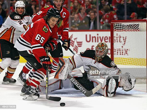 Andrew Shaw of the Chicago Blackhawks gets off a shot against Frederik Andersen of the Anaheim Ducks at the United Center on October 26 2015 in...