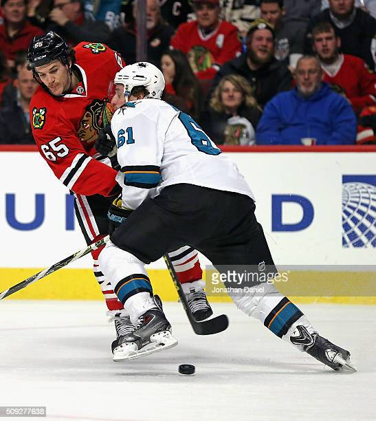 Andrew Shaw of the Chicago Blackhawks gets off a shot that goes underneath Justin Braun of the San Jose Sharks at the United Center on February 9...
