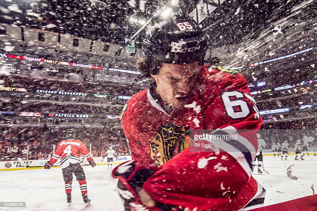 Andrew Shaw #65 of the Chicago Blackhawks is sprayed with water prior to the NHL game against the Pittsburgh Penguins at the United Center on January 6, 2016 in Chicago, Illinois.