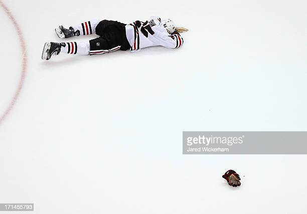 Andrew Shaw of the Chicago Blackhawks lies on the ice following a play in the first period against the Boston Bruins during Game Six of the Stanley...