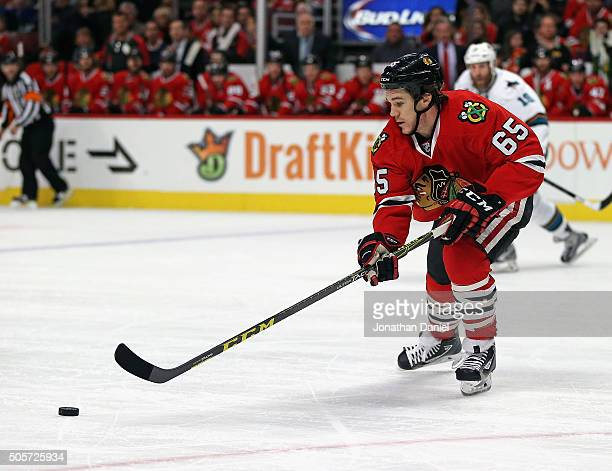 Andrew Shaw of the Chicago Blackhawks passes against the San Jose Sharks at the United Center on December 20 2015 in Chicago Illinois The Blackhawks...