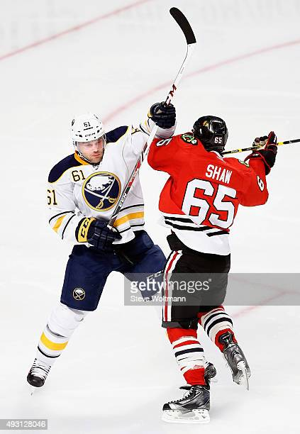 Andrew Shaw of the Chicago Blackhawks plays against Andre Benoit of the Buffalo Sabres during the game at the United Center on October 11 2014 in...