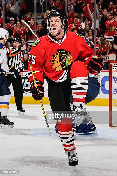 Andrew Shaw of the Chicago Blackhawks reacts after scoring against the St Louis Blues in the third period of the NHL game at the United Center on...
