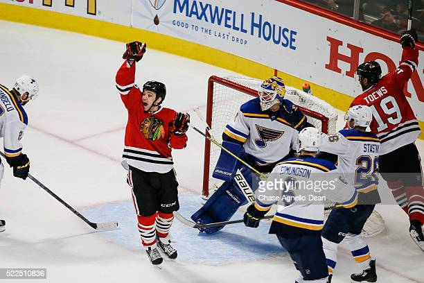 Andrew Shaw of the Chicago Blackhawks reacts after scoring against the St Louis Blues in the second period of Game Four of the Western Conference...