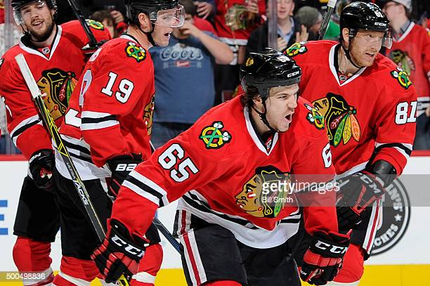 Andrew Shaw of the Chicago Blackhawks reacts in front of David Rundblad Jonathan Toews and Marian Hossa after scoring against the Nashville Predators...