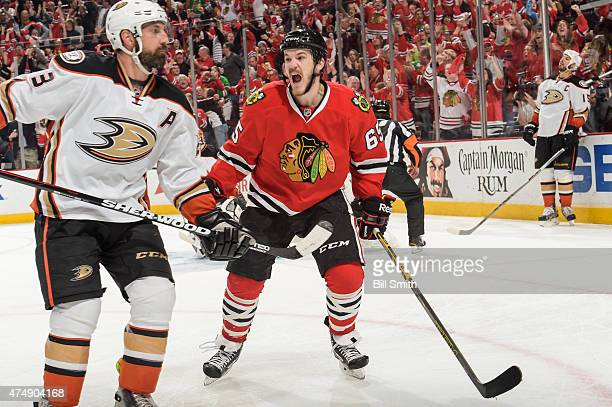Andrew Shaw of the Chicago Blackhawks reacts next to Francois Beauchemin of the Anaheim Ducks after scoring in the third period in Game Six of the...