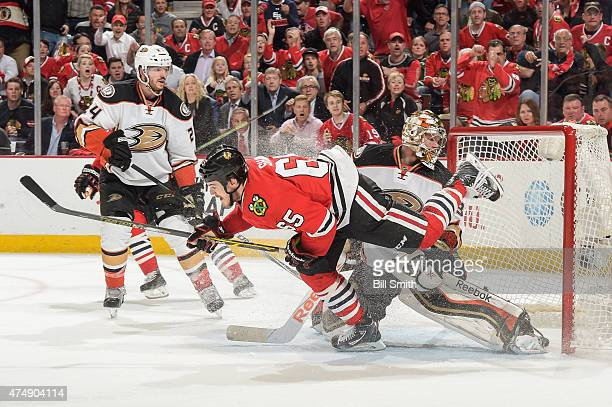 Andrew Shaw of the Chicago Blackhawks scores on goalie Frederik Andersen of the Anaheim Ducks in the third period as Simon Despres watches in Game...