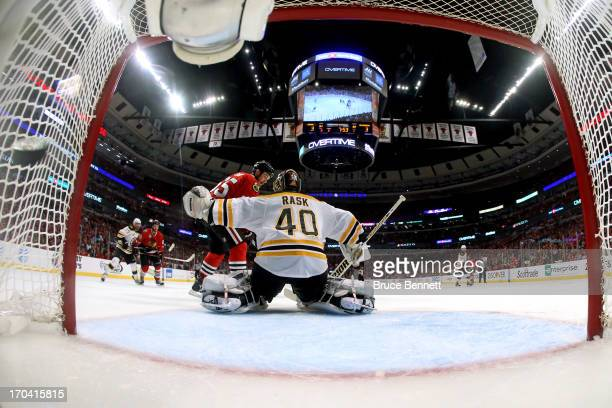 Andrew Shaw of the Chicago Blackhawks scores the gamewinning goal in the third overtime to against goalie Tuukka Rask of the Boston Bruins to give...
