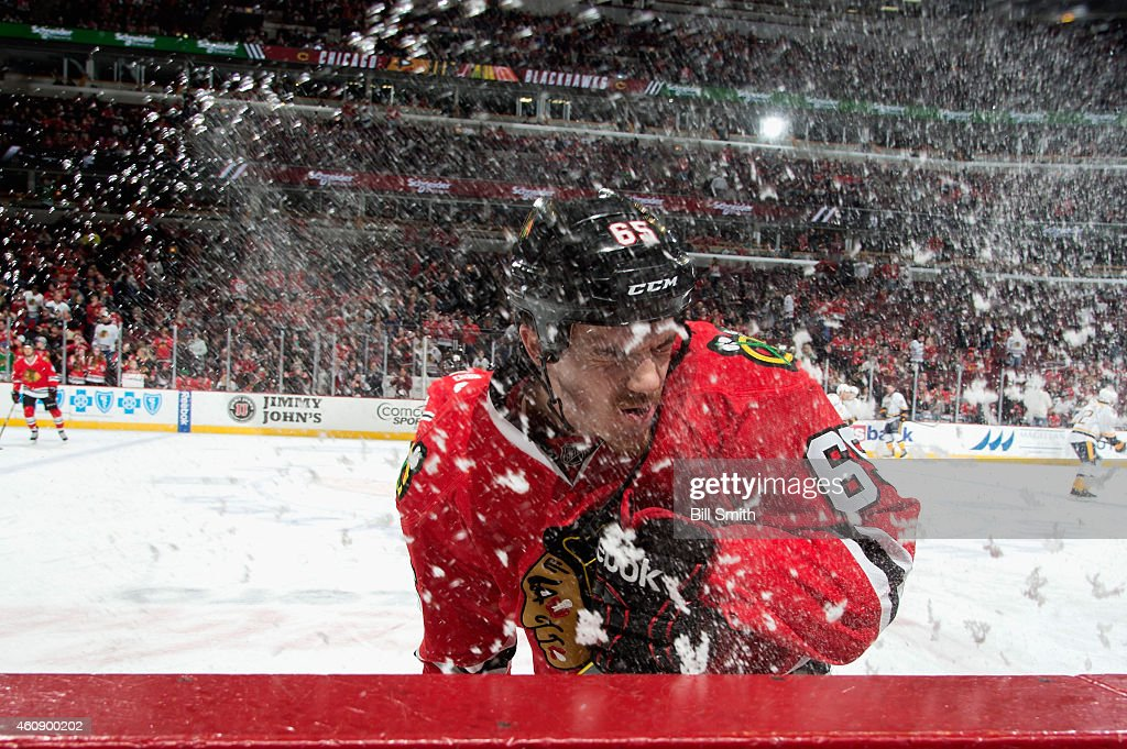 Andrew Shaw #65 of the Chicago Blackhawks sprays ice during the NHL game against the Nashville Predators at the United Center on December 29, 2014 in Chicago, Illinois.