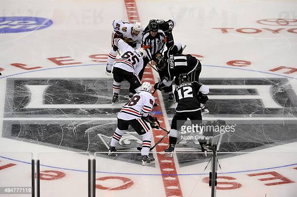 Andrew Shaw of the Chicago Blackhawks takes the faceoff against Anze Kopitar of the Los Angeles Kings in Game Six of the Western Conference Final...