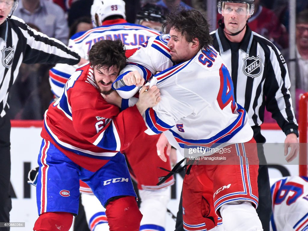 Andrew Shaw #65 of the Montreal Canadiens and Brendan Smith #42 of the New York Rangers exchange punches in Game Five of the Eastern Conference First Round during the 2017 NHL Stanley Cup Playoffs at the Bell Centre on April 20, 2017 in Montreal, Quebec, Canada.