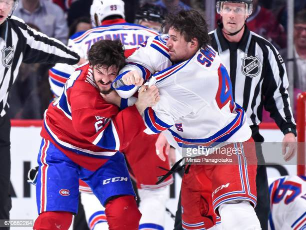 Andrew Shaw of the Montreal Canadiens and Brendan Smith of the New York Rangers exchange punches in Game Five of the Eastern Conference First Round...