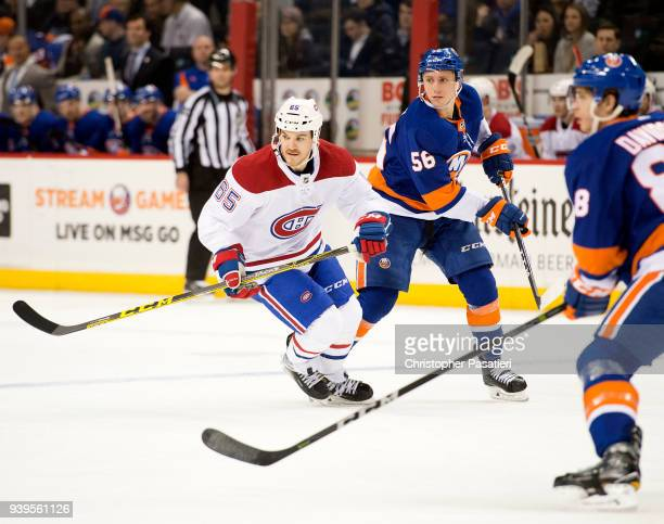 Andrew Shaw of the Montreal Canadiens and Tanner Fritz of the New York Islanders skate during the second period at Barclays Center on March 2 2018 in...